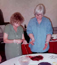 Gloria Lemay teaching placenta examination to Patricia Blomme, R. N. of Calgary, Alberta at the Wise Woman Way of Birth Workshop (2000)